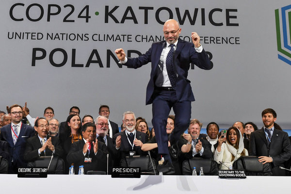 [Polish Public Diplomacy at its best? ]:  Michal Kurtyka, president of the climate talks in Katowice, Poland, leapt over his desk as the final session ended.