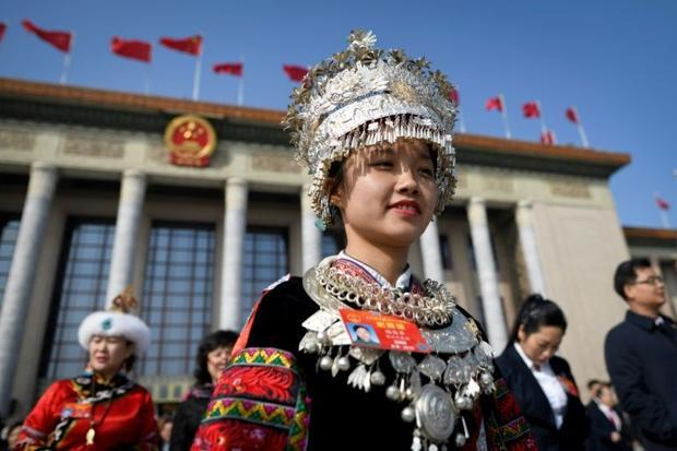 China rolls out rap songs to pump up parliament